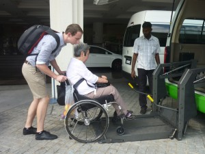 Guest with Caretaker assisted into  Van with Automatic Wheelchair lift